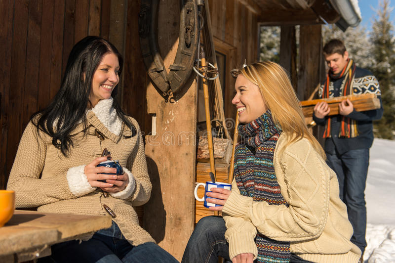 Friends spend holiday winter snow cottage stock photos