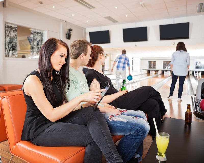 Download Friends Spending Leisure Time In Bowling Club Stock Photo - Image: 37005300