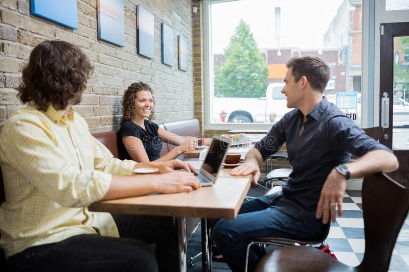 Friends Spending Leisure Time In Cafe Stock Photography