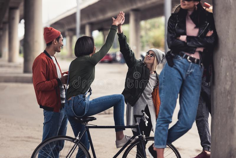 group of young fashionable people with vintage bike spending time stock photos