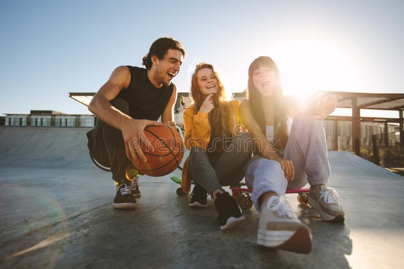 Friends spending time together at skate park royalty free stock photo