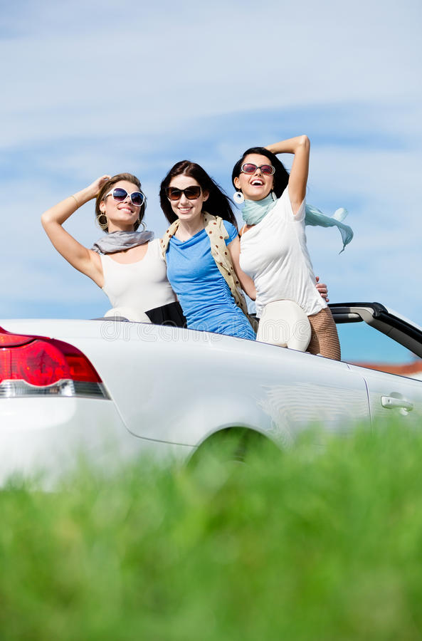 Friends Stand In The Auto With Hands Up Royalty Free Stock Image