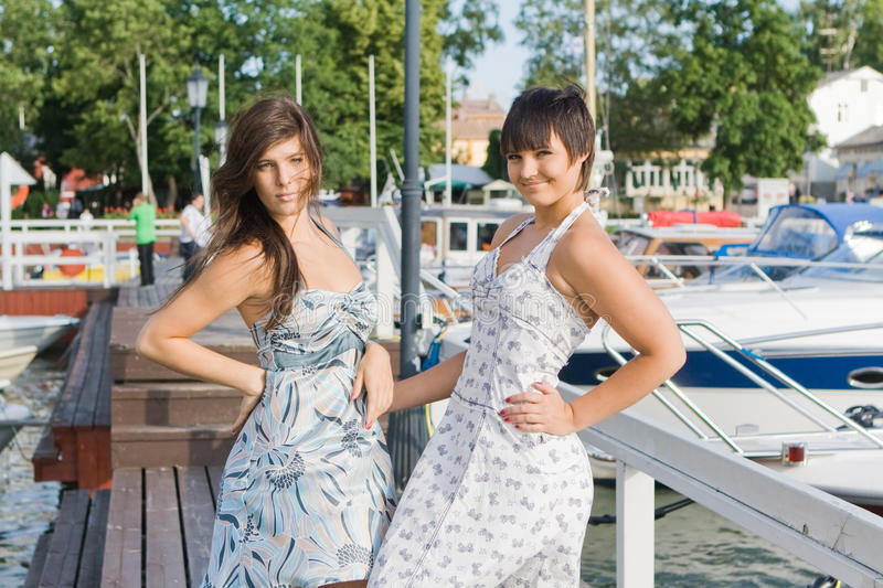 Download Friends staying near boats stock image. Image of trees - 12036403