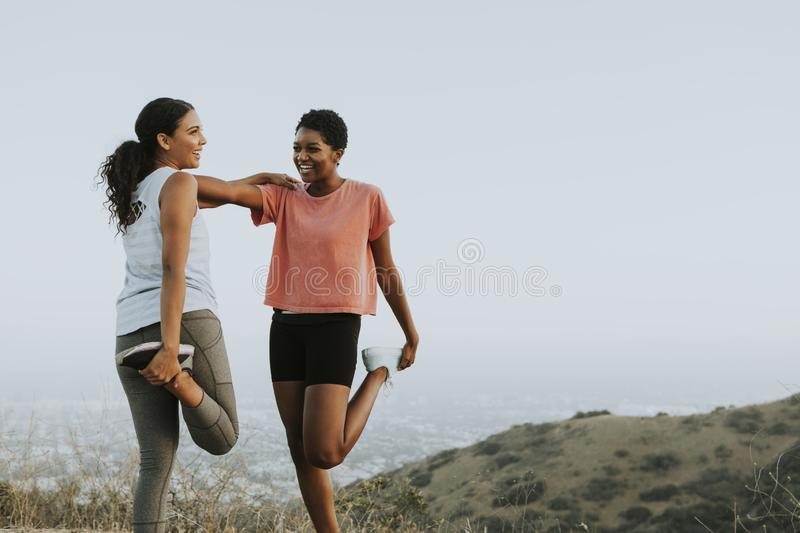 Friends stretching together while on a hike stock image