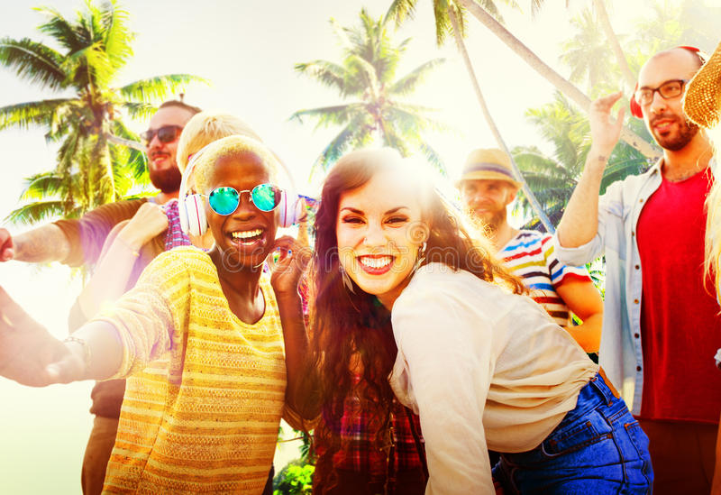 Friends Summer Beach Party Dancing Concept royalty free stock image