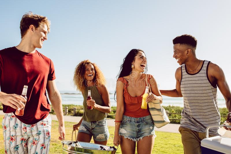 Friends summer beach party. Group of multi-ethnic men and woman together at the beach having fun stock images