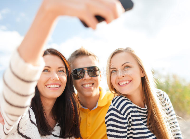 Friends Taking Picture With Smartphone Camera Stock Photos
