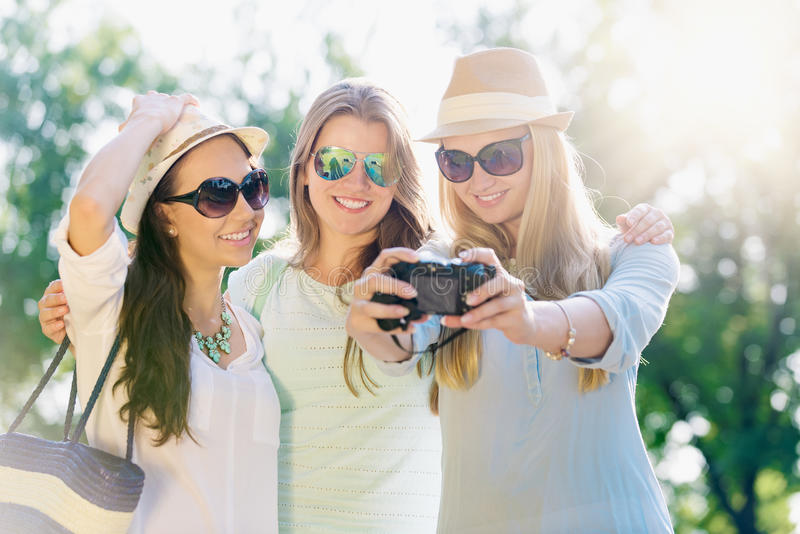 Friends taking picture on their travel vacation royalty free stock photos