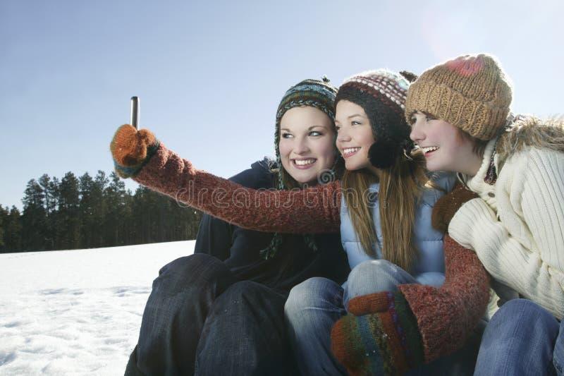 Friends Taking Self Portrait In Snow stock photo
