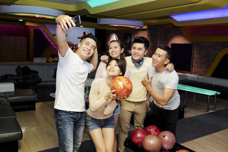 Friends taking selfie in bowling club royalty free stock image