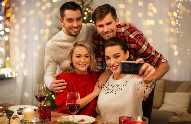Friends taking selfie at christmas dinner stock photography