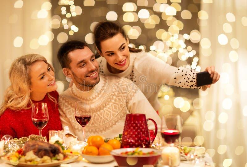 Friends taking selfie at christmas dinner stock image