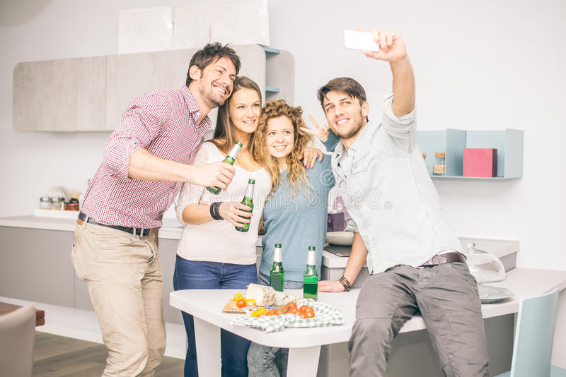 Friends taking selfie at home stock photos
