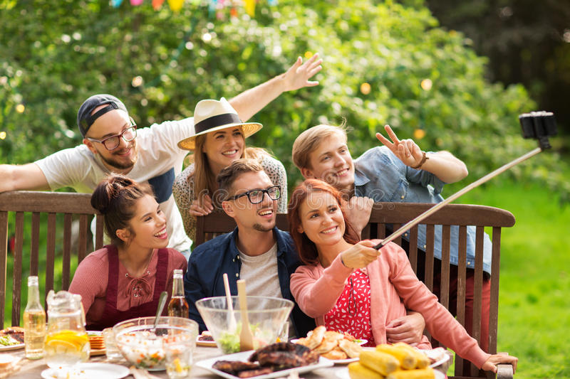 Friends taking selfie at party in summer garden stock images
