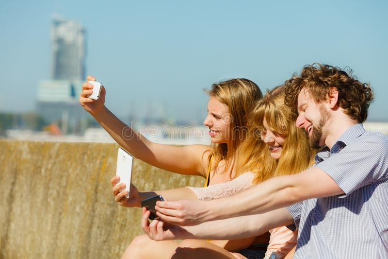 Friends taking selfie photo with smartphone royalty free stock photos