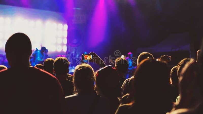 Friends taking a selfie at summer festival concert. Night scene stock photo