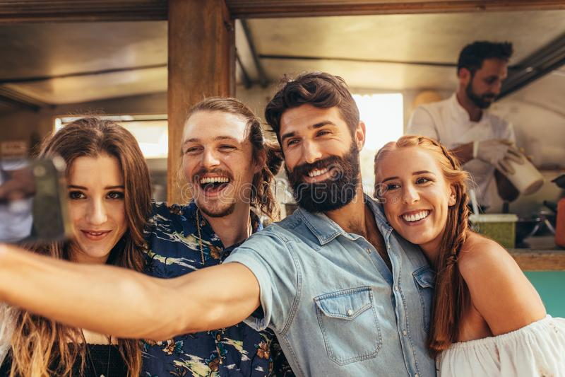 Friends taking selfie at summer festival royalty free stock images
