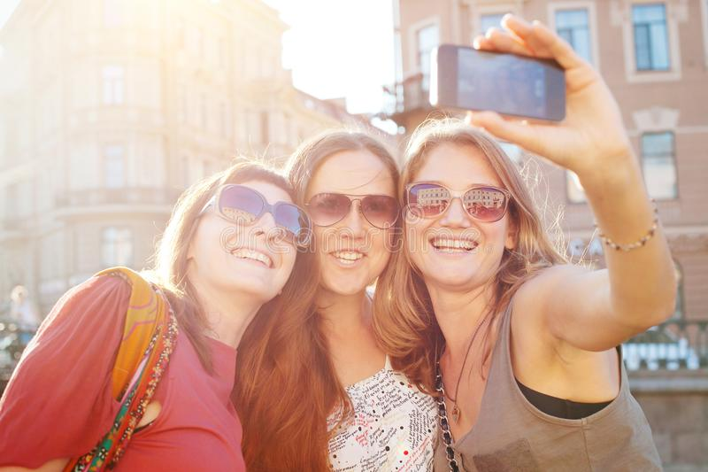 Friends taking selfy, students travel to Europe, girls selfie stock photography