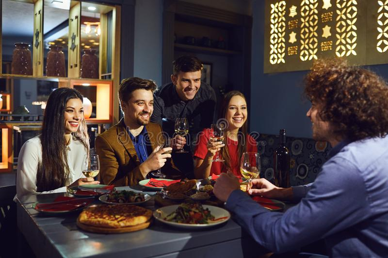 Friends talk fun at the table in the restaurant stock image