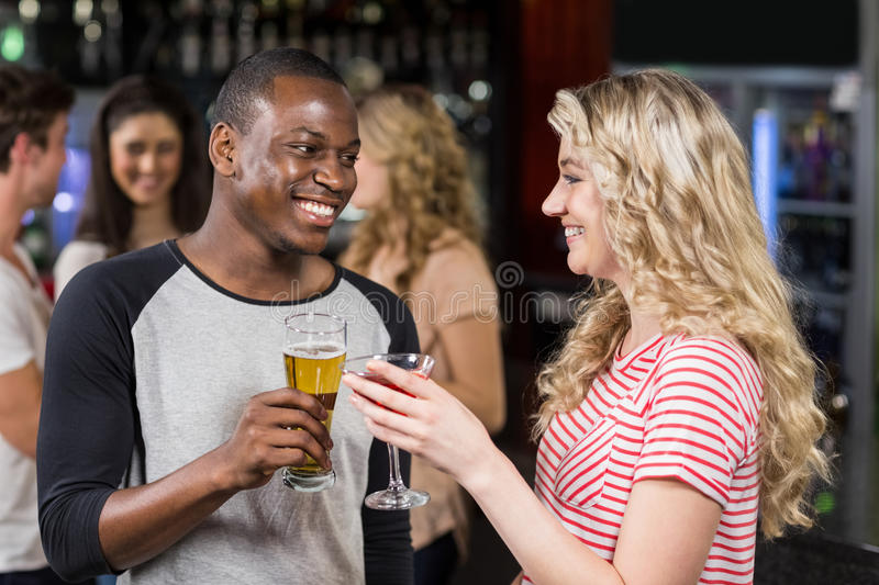 Download Friends Toasting With Cocktail And Beer Stock Photo - Image: 68301322