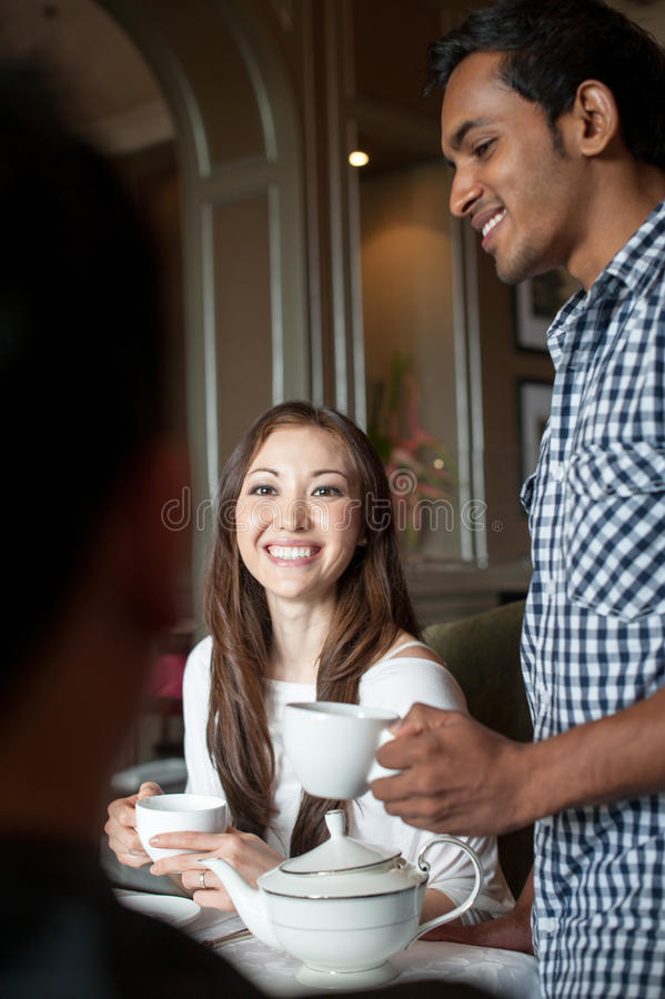 Friends together in a cafe stock photos
