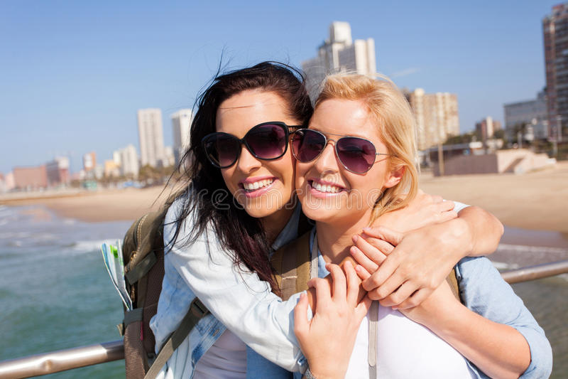 Friends touring Durban. Two happy friends touring Durban, South Africa royalty free stock photography