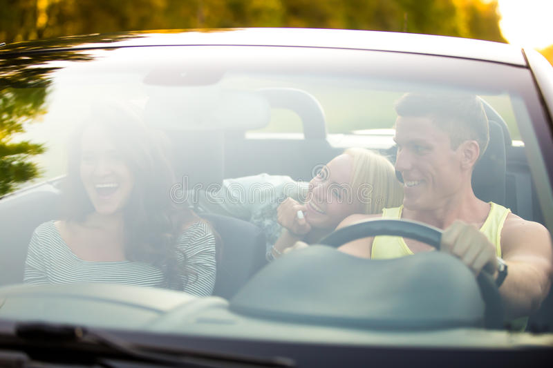 Friends traveling in a car royalty free stock photos