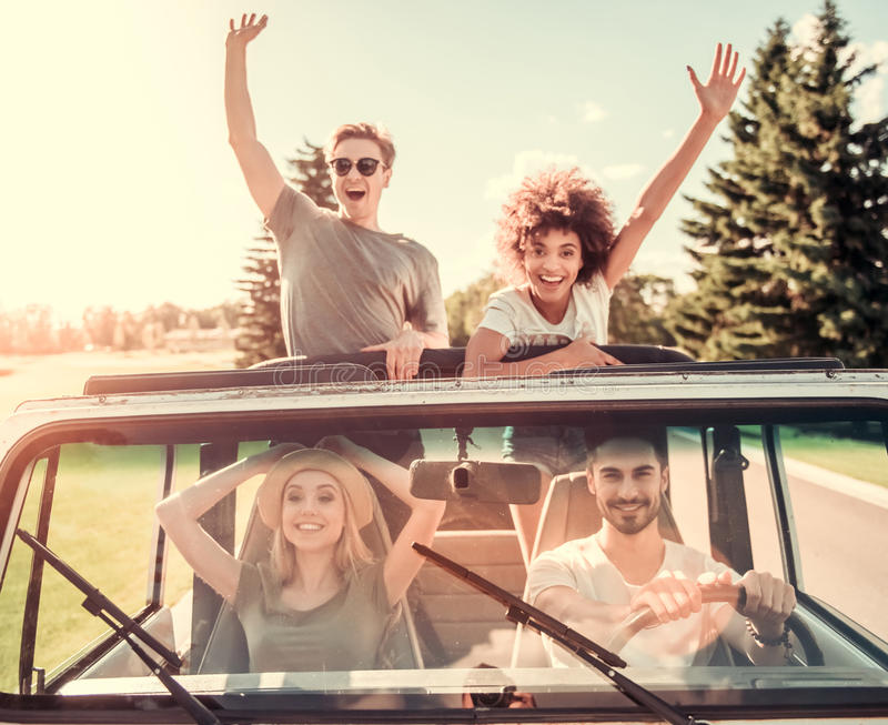 Friends travelling by car stock photo