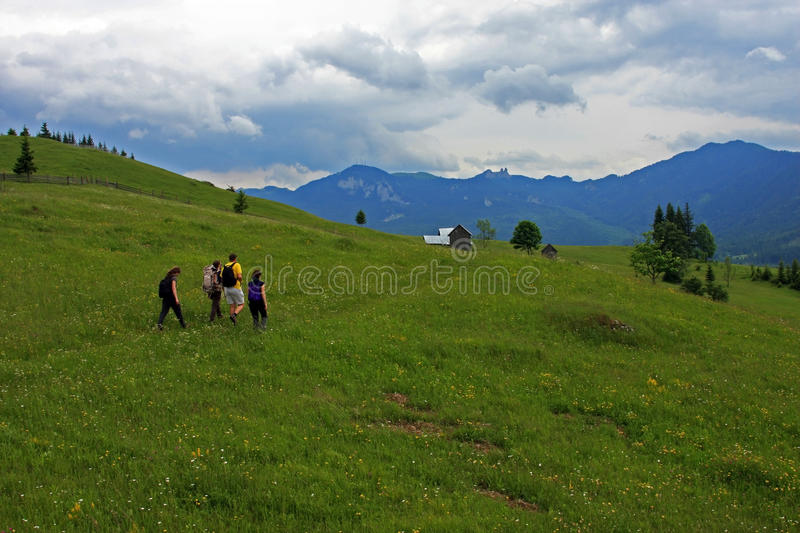Friends trekking in Rarau mountains royalty free stock image