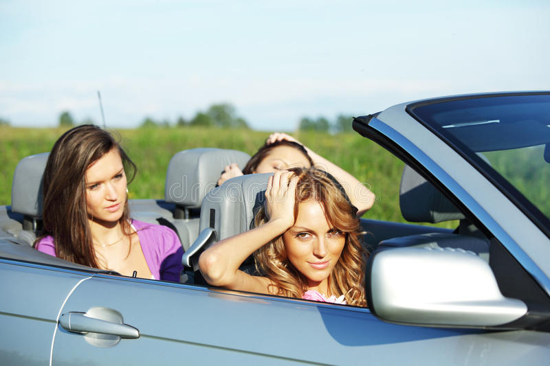 Friends Trip In Cabriolet Royalty Free Stock Image