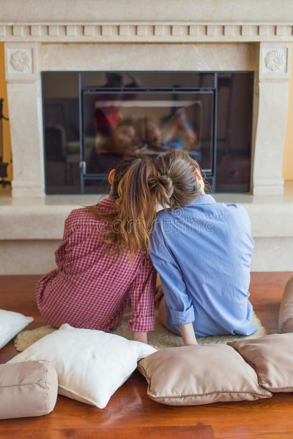 Friends. Two girls sitting in the living room together royalty free stock image