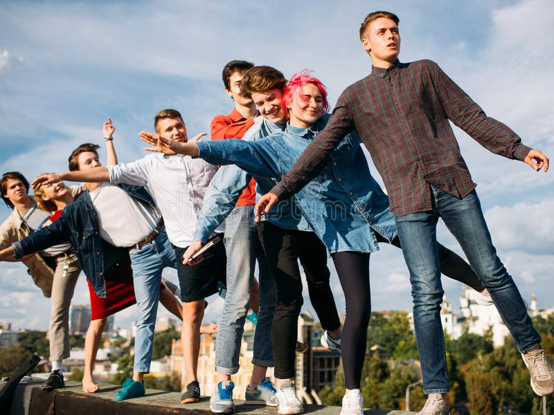 Friend unity dream risk rooftop fun young diverse royalty free stock photos