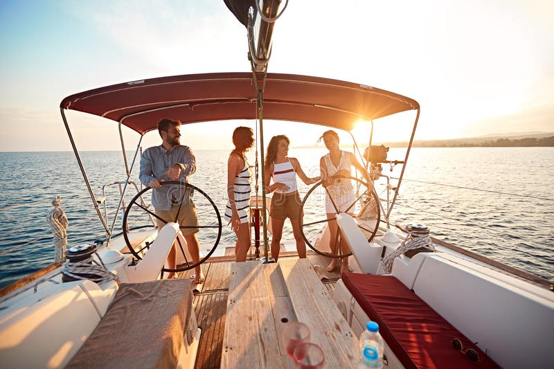Friends on vacation travel on boat together and enjoy at summer day stock photography
