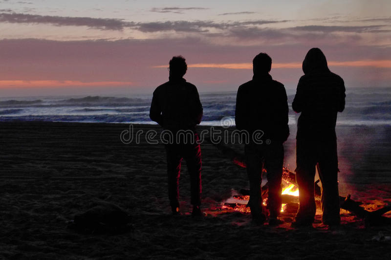 Friends waiting for the sun. stock photo