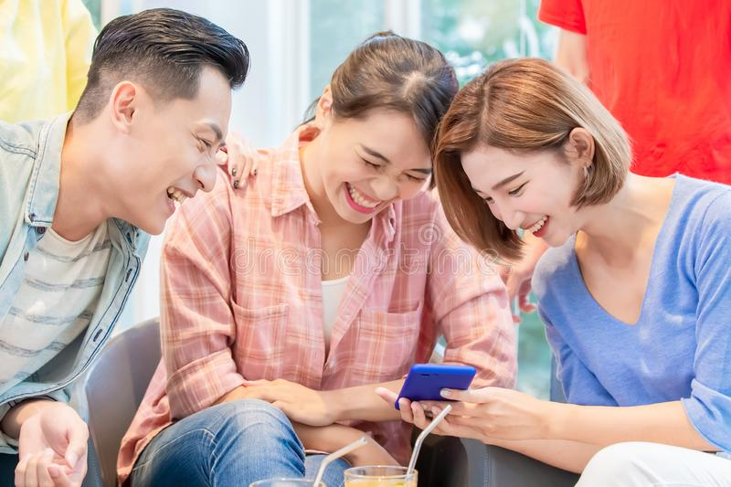 Friends watch smart phone royalty free stock image