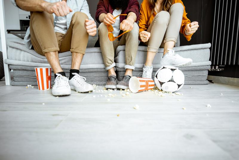 Friends watching football at home stock photo