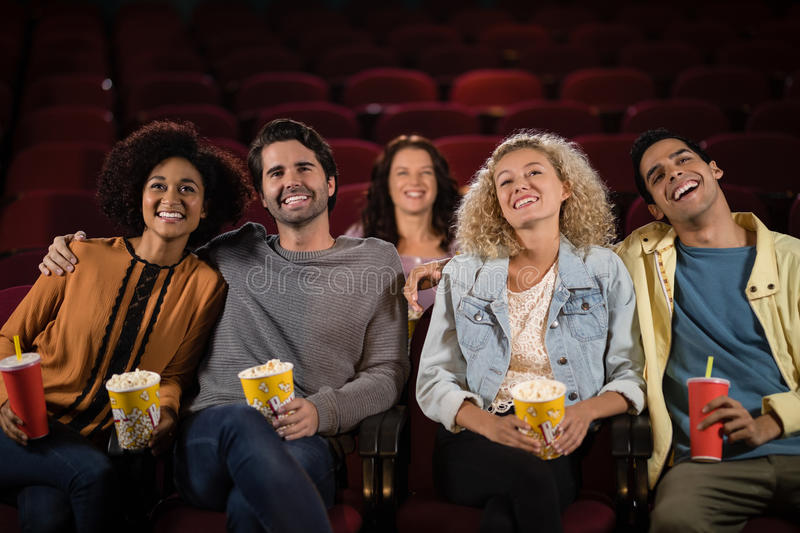 Friends watching movie royalty free stock photography