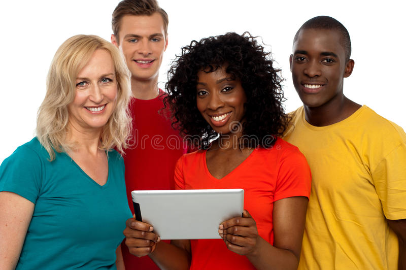 Friends watching video on tablet pc royalty free stock photography