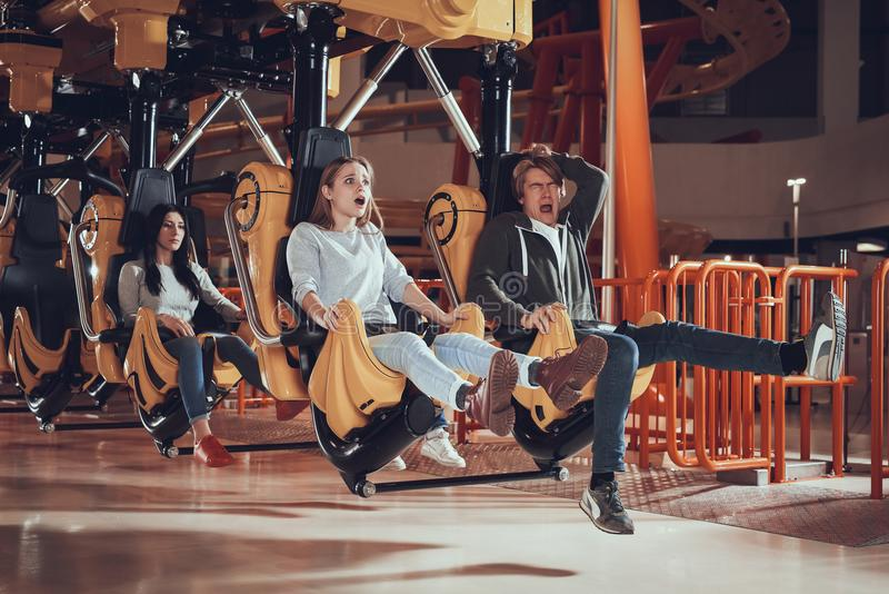 Friends were scared at amusement park. stock image