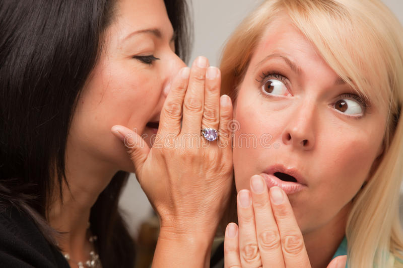 Download Friends Whispering Secrets stock image. Image of rumour - 9752547