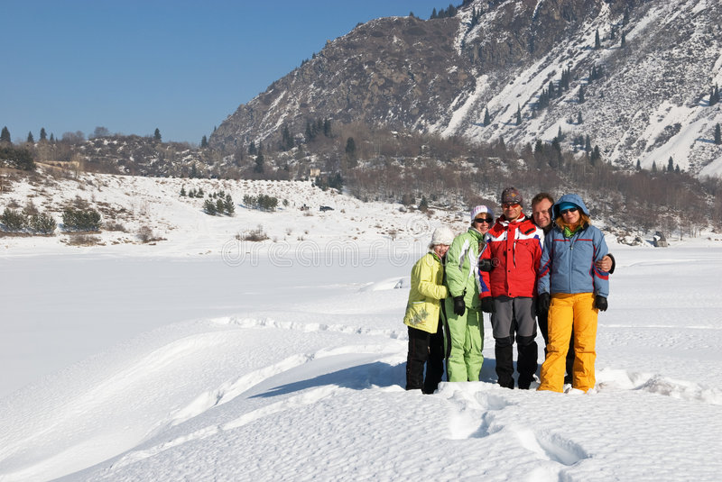 Friends in winter mountain royalty free stock photos