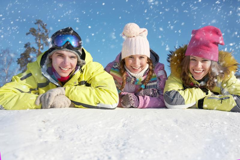 Friends on winter resort royalty free stock photography