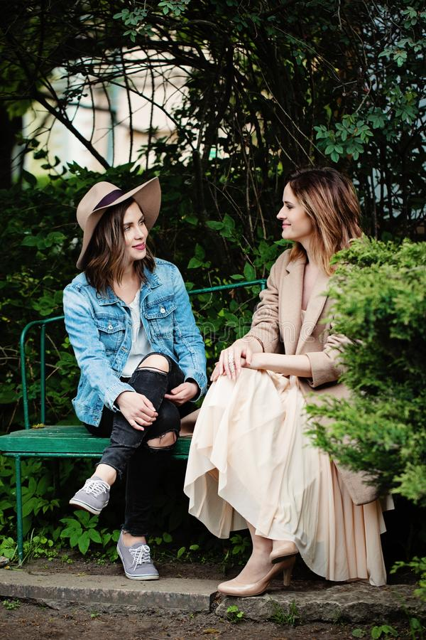 Friends women chatting in park, lifestyle portrait royalty free stock photo