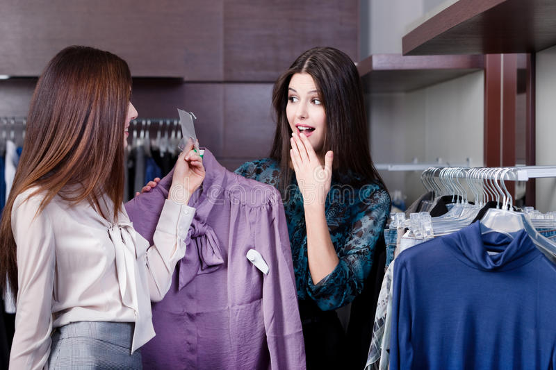 Friends Wonder At Special Prices Stock Photos