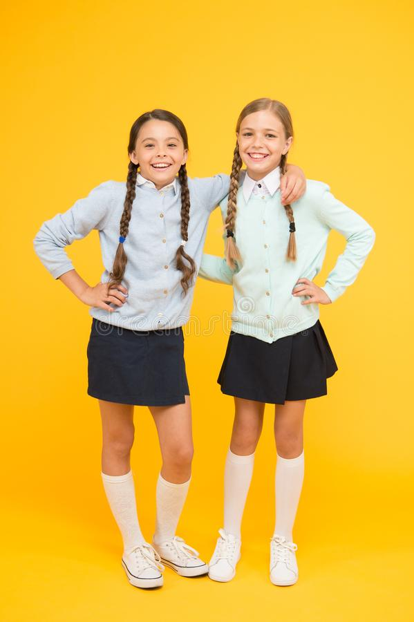 Friendship begins with smile. Happy schoolgirls enjoying bonds of friendship. Little children celebrating friendship day. The glue that holds school friendship stock photo