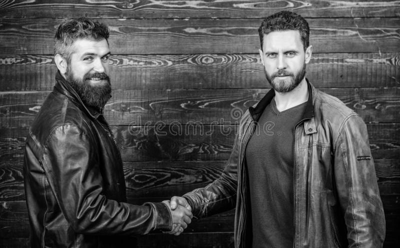 Friendship of brutal guys. Approved business deal. Handshake gesture meaning. Handshake symbol of successful deal. Have royalty free stock image