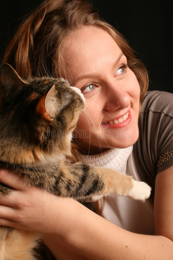 Friendship with cat. True friend stock photos