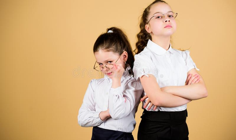 Friendship forever. back to school. study concept. smart small girls at lesson. small girls in school uniform. confident stock photography