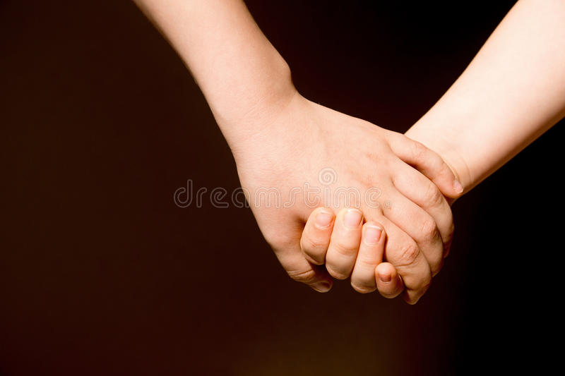 Friendship forever. Concept. Children holding hands, close up, copy space royalty free stock photos