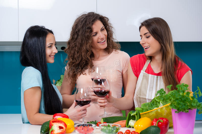 Friendship and good time over a glass of wine. stock image